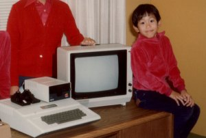 Adam with one of his first computers, an Apple ][