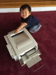 Dash has fun opening and closing the various paper trays of the old HP LaserJet 6MP.