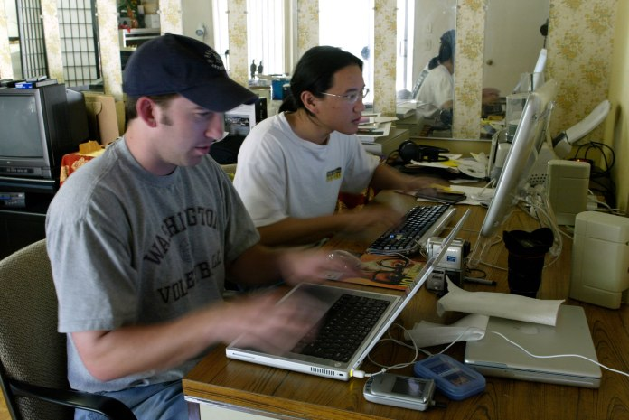 Furiously typing away on our keyboards for the camera's sake on February 26, 2003.