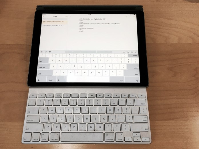 The iPad Pro's software keyboard, shown here next to the Apple Wireless Keyboard, is nearly full-sized.