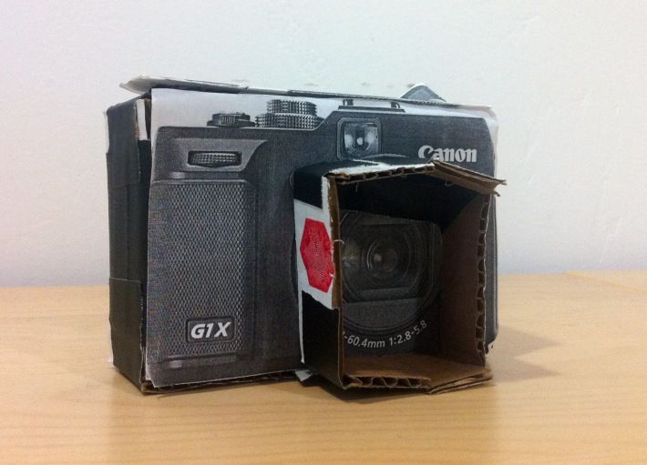 Before the G1X was released, I made a paper mockup of it to gauge its size and weight compared to my phone and DSLR.