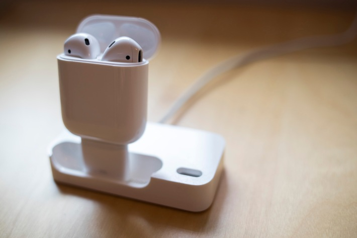 A new use for the old original Apple Bluetooth Headset dock. With a 30-pin to Lightning adapter, the dock can now charge Apple's next generation of Bluetooth headset, the AirPods.